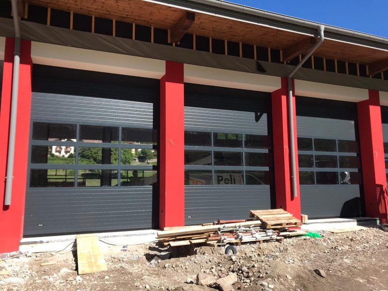 Installazione porte sezionali vigili del fuoco Condino